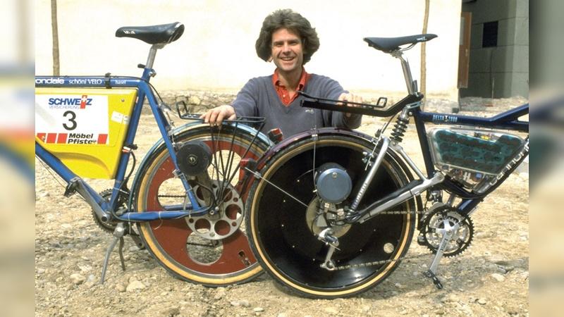 Die ersten Pedelecs überhaupt baute der Basler Michael Kutter: Der blaue Prototyp gewann die Elektrofahrzeug-Rally Tour de Sol, und mit dem vollgefederten Velocity startete die kommerzielle Fertigung.